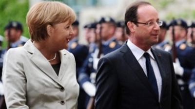 Μέρκελ - Ολάντ: «Να δείξουν οι Έλληνες ότι θέλουν την Ευρώπη»