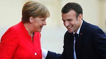 Ο Μακρόν στο Βερολίνο: Τα χαμόγελα & οι δισταγμοί της Μέρκελ